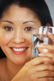 young lady with glass of water