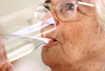 older woman drinking water
