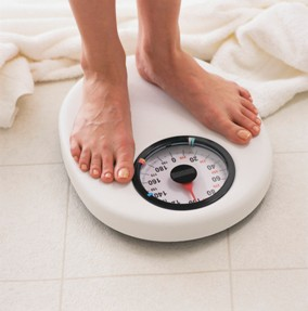 standing on a weight scale
