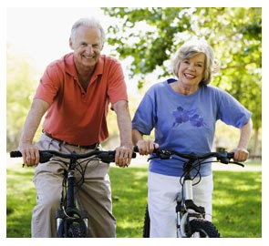 two elderly adults on bikes